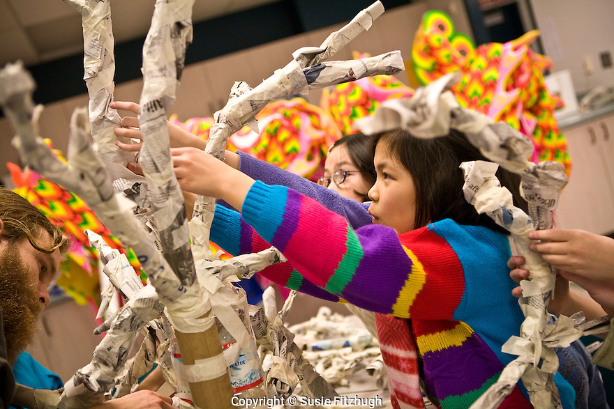 "Students in Lana Sundberg's Visual Art class at Kimball Elementary School, Seattle, make creatures for an Arts Corps/Planet Arc sculptural piece celebrating the ""Seeds of Compassion"" movement."