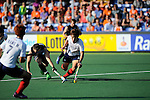 The Hague, Netherlands, June 01: Shea McAleese #25 of New Zealand and Seongkyu Kim #22 of Korea battle for the ball during the field hockey group match (Men - Group B) between the Black Sticks of New Zealand and Korea on June 1, 2014 during the World Cup 2014 at GreenFields Stadium in The Hague, Netherlands. Final score 2:1 (1:0) (Photo by Dirk Markgraf / www.265-images.com) *** Local caption ***