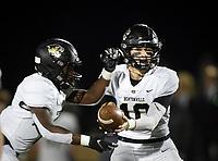 NWA Democrat-Gazette/CHARLIE KAIJO Bentonville Ben Pankau (10) hands the ball of to Preston Crawford (1) Friday, November 8, 2019 during a football game at Bentonville West High School in Centerton.