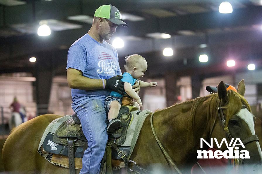 NWA Democrat-Gazette/BEN GOFF @NWABENGOFF<br />  Thursday, Aug. 8, 2019, during the team roping event during Benton County Fair in Bentonville.