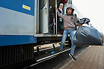 A refugee climbs down from a train as it arrives in the Hungarian town of Hegyeshalom. Migrants and refugees aboard the train walk from here across the border into Austria. Hundreds of thousands of refugees and migrants flowed through Hungary in 2015, on their way to western Europe from Syria, Iraq and other countries.