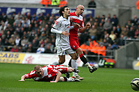 ATTENTION SPORTS PICTURE DESK<br /> Pictured: Jordi Gomez of Swansea (C) brought down by Nicky Bailey of Charlton (L) while challenged at the same time by Jonjo Shelvey (R). Bailey saw a yellow card for this foul by referee K Stroud (not pictured.<br /> Re: Coca Cola Championship, Swansea City FC v Charlton Athletic at the Liberty Stadium, Swansea, south Wales. 28 February 2009<br /> Picture by D Legakis Photography / Athena Picture Agency, Swansea 07815441513
