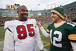 Green Bay Packers quarterback Aaron Rodgers (12) and Tampa Bay Buccaneers defensive lineman Albert Haynesworth (95) after a Week 11 NFL football game on November 20, 2011 in Green Bay, Wisconsin. The Packers won 35-26. (AP Photo/David Stluka)