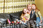 Kayla and Kirsten McGaley at home with their mother Deirdre in Castleisland.