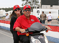 Mar. 17, 2013; Gainesville, FL, USA; NHRA team owner Don Schumacher with daughter Megan Schumacher after winning the Gatornationals at Auto-Plus Raceway at Gainesville. Mandatory Credit: Mark J. Rebilas-