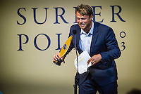 North Shore, Oahu, Hawaii (Friday, December 6, 2013) Dane Reynolds (USA). &ndash; The 44th Annual Surfer Poll Awards  were held tonight at the Turtle Bay Resort on the North Shore of O&rsquo;ahu. The ceremony brought together the best surfers, filmmakers, and surf legends all under one roof to honor the best films and performances of the year.<br /> <br /> Each year the SURFER staff pores through all of the full-length films and web shorts produced that year, narrowing down hundreds of great rides and notable moments to just a handful of nominees. And while it&rsquo;s always a challenge, this year there was one surfer/co-director who dominated the movie categories: John John Florence (HAW). Not only was he voted second in the reader poll, he also took home Best Performance for his surfing in Done, Best Short for his film Begin Again and Movie of the Year for Done, both of which he co-directed with Blake Kueny (USA).<br /> <br /> For the Men&rsquo;s reader poll, it came as no surprise that once again Kelly Slater (USA) who took the No. 1 slot, making this his 19th Surfer Poll win since he first topped the list in 1993. On the women&rsquo;s side of the poll, it was Alana Blanchard (HAW) who was voted into the top slot over current World Champion Carissa Moore  (HAW) (Women&rsquo;s No. 3) and five-time World Champion Steph Gilmore (AUS) (Women&rsquo;s No 5). This is her first time winning the Women&rsquo;s No. 1 award, up from No. 2 in 2012.  Photo: joliphotos.com
