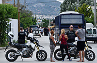 "Pictured: Police prsencel in Acharnes, Athens, Greece. Friday 09 June 2017<br /> Re: An 11 year old boy has been shot dead by a ""stray bullet"" during a school celebration in Acharnes (Menidi) area, in the outskirts of Athens, Greece.<br /> Marios Dimitrios Souloukos ""complained to his mum"" who works as a teacher at the 6th Primary School of Acharnes that he was feeling unwell, he then collapsed with blood pouring out from the top of his head.<br /> His mum tried to revive him assisted by other teachers while his schoolmates who were reportedly upset, were hurriedly removed by their parents.<br /> According to locals an ambulance arrived 25 minutes late.<br /> Hundreds of police officers have been deployed in the area and have raided many properties.<br /> Shells matching the fatal bullet which hit the boy on the top of his head were found in a house yard nearby.<br /> Local people reported hearing shots being fired at a nearby Romany Gypsy camp before the fatal incident.<br /> The area has been plagued with criminality during the last few years."
