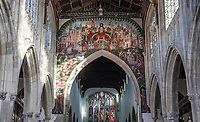BNPS.co.uk (01202 558833)<br /> Pic: PhilYeomans/BNPS<br /> <br /> The chapel is the original Parish church of Salisbury, where the masons building the famous cathedral would have worshipped.<br /> <br /> Doom finally has its day! - A 500 year old 'Day of Judgement' painting, that has survived Henry VIII th, the Puritans and even Victorian prudery has been restored to its former glory.<br /> <br /> Thought to be the largest medieval 'Doom' painting in the country, the striking image been painstakingly restored after a tumultuous 500 year history on the chancel arch of St Thomas Becket church in Salisbury.<br /> <br /> Originally painted in the 15th century, the chancel was white-washed during the Reformation before being uncovered nearly 300 years later in the early 19th century. <br /> <br /> Prudish Victorian's shocked by the naked images then recovered it before it finally re-emerged in 1881 as opinions relaxed. <br /> <br /> Experts have spent three months conserving the faded painting, which included injecting lime slurry behind areas of paint to affix them again to the wall. and delicately 'touching up' in places before finishing it with varnish to bring out its colour.<br /> <br /> Most pre 16th century churches and cathedrals in Britain would have been plastered with religious images and iconography to encourage their often illiterate congregation to good behaviour.<br /> <br /> But during Henry VIII th Protestant Reformation churches were stripped of all graven imagery and the paintings were either whitewashed over or completely destroyed.<br /> <br /> Because of this very few works still survive today making the Salisbury fresco a truly remarkable survivor.<br /> <br /> The restoration is part of a larger set of works at the historic church which are due to cost £1.5million.