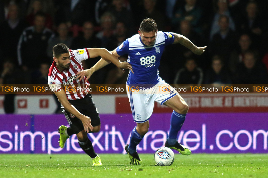 Harlee Dean of Birmingham tries to shake off a challenge from Brentford's Neal Maupay during Brentford vs Birmingham City, Sky Bet EFL Championship Football at Griffin Park on 2nd October 2018