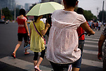 Pedestrians cross the street in downtown Beijing, China on Wednesday, August 6, 2008. The city of Beijing is gearing up for the opening ceremonies of the Olympic Games.  Kevin German