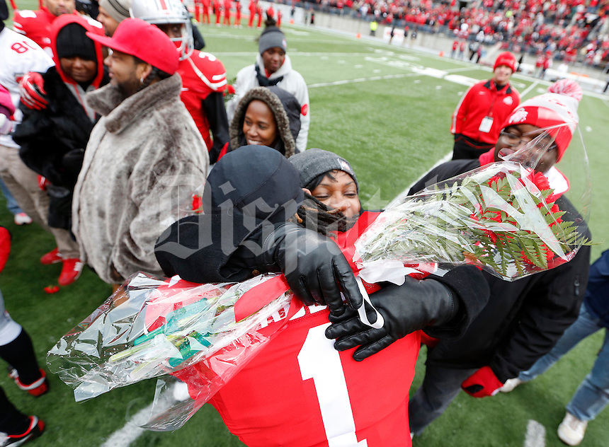 Ohio State Buckeyes cornerback Bradley Roby (1) embraces a family member during Senior Day celebration before the college football game between the Ohio State Buckeyes and the Indiana Hoosiers at Ohio Stadium in Columbus, Saturday afternoon, November 23, 2013. The Ohio State Buckeyes defeated the Indiana Hoosiers 42 - 14. (The Columbus Dispatch / Eamon Queeney)
