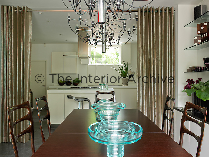 The open-plan kitchen and dining area can be separated by a pair of curtains
