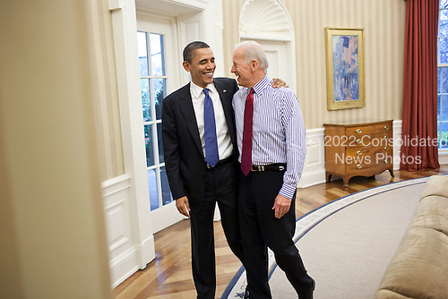 United States President Barack Obama embraces Vice President Joe Biden in the Oval Office after a meeting on the budget, April 8, 2011. .Mandatory Credit: Pete Souza - White House via CNP