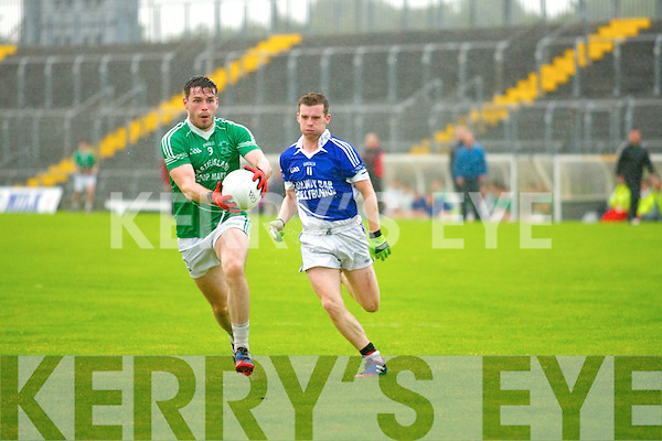 Gearoid McCarthy (St Kierans) in action with Darren Russell (Shannon Rangers) in the Acorn Life under 21 County Football Championship Semi Final at Austin Stack Park, Tralee on Wednesday evening.