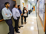 Ole Miss pharmacy students check out the posters detailing the research their classmates are conducting in UM's National Center for Natural Products Research. Photo by Robert Jordan/Ole Miss Communications
