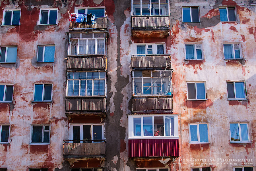 Russia, Sakhalin, Yuzhno-Sakhalinsk. An old Soviet era apartment block.