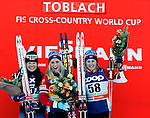 Krista Parmakoski, Therese Johaug, Ingvild Flugstad Oestberg at the podium of the FIS Cross Country Ski World Cup 10 Km Individual Classic race in Dobbiaco, Toblach a, on December 20, 2015. Norway's Therese Johaug wins. Credit: Pierre Teyssot