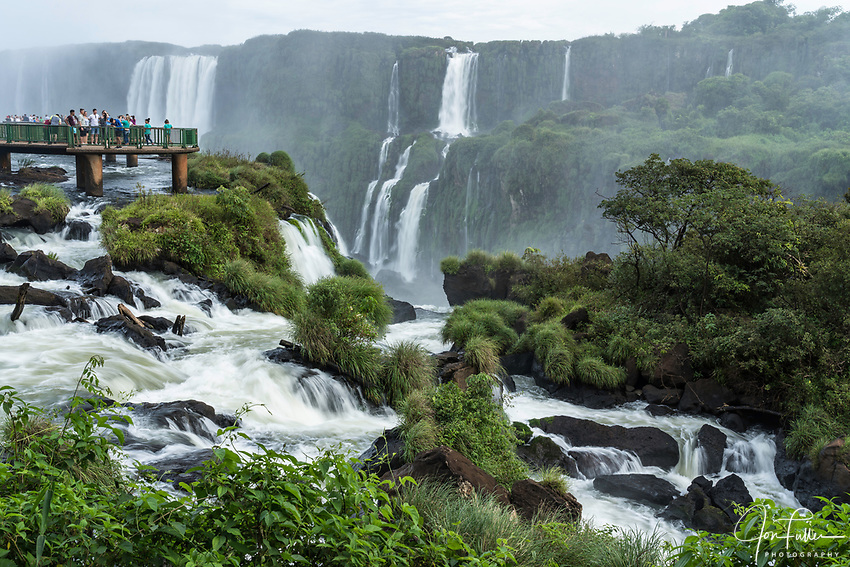 Iguazu Falls National Park in Brazil in the foreground and Argentina in the background.  A UNESCO World Heritage Site.  Across the river canyon in Argentina are Mitre Falls at left and Belgrano Falls at right.