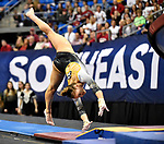 The SEC National Gymnastic Championship was held on Saturday March 24 at Chaifetz Arena on the Saint Louis University campus. Mizzou's Morgan Porter starts her flip as she approaches the vault.<br />Photo by Tim Vizer