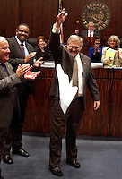TALLAHASSEE, FL. 4/30/04-Unable to get the House to agree to the traditional Sine Die ceremony, Senate Sergeant at Arms Donald Severance drops his handkerchief in the center of the Senate chamber to signal the end of the 2004 legislative session, Friday at the Capitol in Tallahassee. Sens. Durell Peaden, R-Crestview, left, and Al Lawson, D-Tallahassee watch Severance up close as Senate President Jim King, R-Jacksonville, prepares to gavel his chamber to a close. Usually Severance meets his house counterpart midway between the chambers where they simultaneously drop their handkerchiefs signaling session's end. COLIN HACKLEY PHOTO