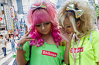 Two young Japanese women dressed in Shibuya Gyaru style in ShinjukuShinjuku, Tokyo, Japan. Friday June 23rd 2017