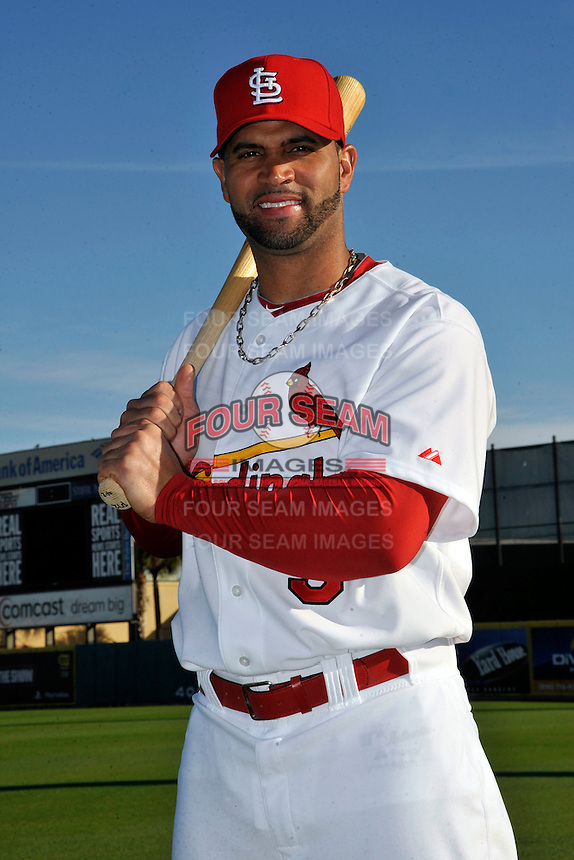 Mar 01, 2010; Jupiter, FL, USA; St. Louis Cardinals infielder Albert Pujols (5) during  photoday at Roger Dean Stadium. Mandatory Credit: Tomasso De Rosa/ Four Seam Images