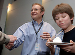 MELVILLE,NY-MONDAY APRIL 16, 2007: Newsday Cartoonist, Walter Handelsman with son Billy age 12,  celebrating at an acknowlegement ceremony for his winning of the Pulitzer for a Portfolio of Editorial Cartoons, in the Auditorium of Newsday offices in Melville on Monday April 16, 2007. Photo by/Jim Peppler.