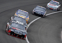 Feb 22, 2009; Fontana, CA, USA; NASCAR Sprint Cup Series driver David Stremme leads a pack of cars during the Auto Club 500 at Auto Club Speedway. Mandatory Credit: Mark J. Rebilas-