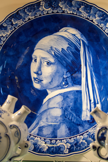 A Delft porcelain plate picturing The Girl with the Pearl Earring in Amsterdam in the Netherlands (Holland).