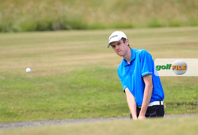Adam Cromwell (Co. Armagh) plays out of a bunker onto the 7th green during Round 2 of the Ulster Boys Championship at Castlerock Golf Club on Wednesday 1st July 2015.<br /> Picture:  Golffile | Thos Caffrey