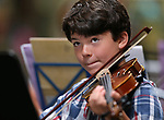 Nathan Powers, 11, performs at the Carson City Symphony's Youth Strings Summer Program concert in Carson City, Nev., on Thursday, July 27, 2017. <br />