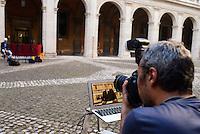 Roma 18 Settembre 2103<br /> Riunione a Sant'Ivo alla Sapienza della Giunta per l'Immunità del Senato che dovrà valutare la decadenza di Silvio Berlusconi da senatore. Primo verdetto della Giunta per le autorizzazioni, respinta la relazione Augello. Un fotoreporter riprende il video messaggio di Berlusconi.<br />  A special Italian Senate committee is held to consider expelling Silvio Berlusconi following his conviction for tax fraud