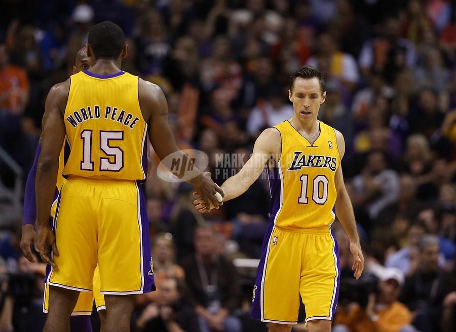 Jan. 30, 2013; Phoenix, AZ, USA: Los Angeles Lakers guard Steve Nash (10) and Metta World Peace (15) against the Phoenix Suns at the US Airways Center. Mandatory Credit: Mark J. Rebilas-