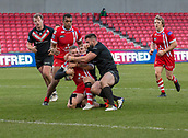 10th February 2019, AJ Bell Stadium, Salford, England; Betfred Super League rugby, Salford Red Devils versus London Broncos; Jackson Hastings of Salford Red Devils is tackled by Alex Walker and Eloi Pelissier of London Broncos