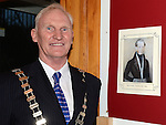 Chairperson Fintan Malone with photo of the first Chairperson William Hatchat the Ardee Town Council reunion for past members held in Ardee Castle. Photo:Colin Bell/pressphotos.ie