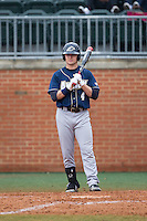 Daulton Mosbarger (4) of the Akron Zips checks the sign with his third base coach during the game against the Charlotte 49ers at Hayes Stadium on February 22, 2015 in Charlotte, North Carolina.  The Zips defeated the 49ers 5-4.  (Brian Westerholt/Four Seam Images)