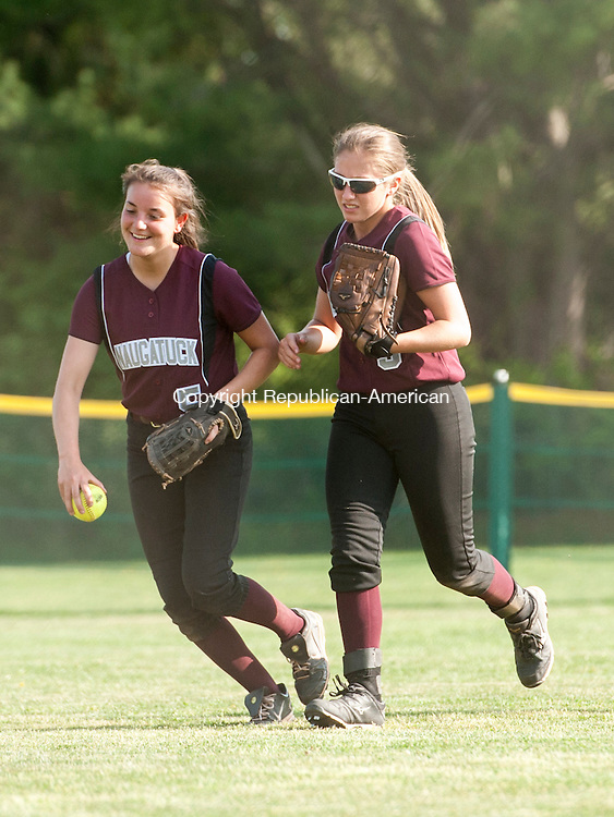 WATERTOWN, CT-11 May 2015-051115EC07-  Naugatuck's Tabitha Genovese (5) and Erica Andreoli (9) run off the field after a Watertown ball is caught by Andreoli in the outfield Monday. Erin Covey Republican-American