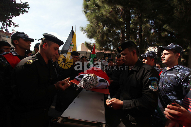 Palestinian policemen carry the body of their comrade Rushdi Tamimi, 31, during his funeral procession in the West Bank city of Ramallah November 20, 2012. amimi was wounded during a protest against Israel's operation in Gaza on Saturday, Nov. 17, 2012. Efforts to end a week-old convulsion of Israeli-Palestinian violence drew in the world's top diplomats on Tuesday, with President Barack Obama dispatching his secretary of state to the region on an emergency mission and the U.N. chief appealing from Cairo for an immediate cease-fire. Photo by Issam Rimawi