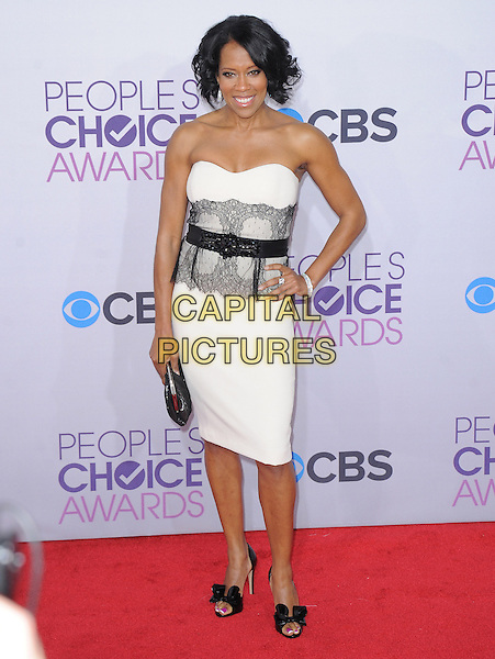 Regina King.The 2013 People's Choice Awards held at Nokia Live in Los Angeles, California 9th January 2013                                                                   .full length white strapless dress lace clutch bag belt black hand on hip  .CAP/DVS.©DVS/Capital Pictures.