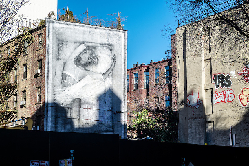 New York, NY - French Graffiti Artist JR's portrait of Charlotte Ranson on the wall of an East Village tenement.