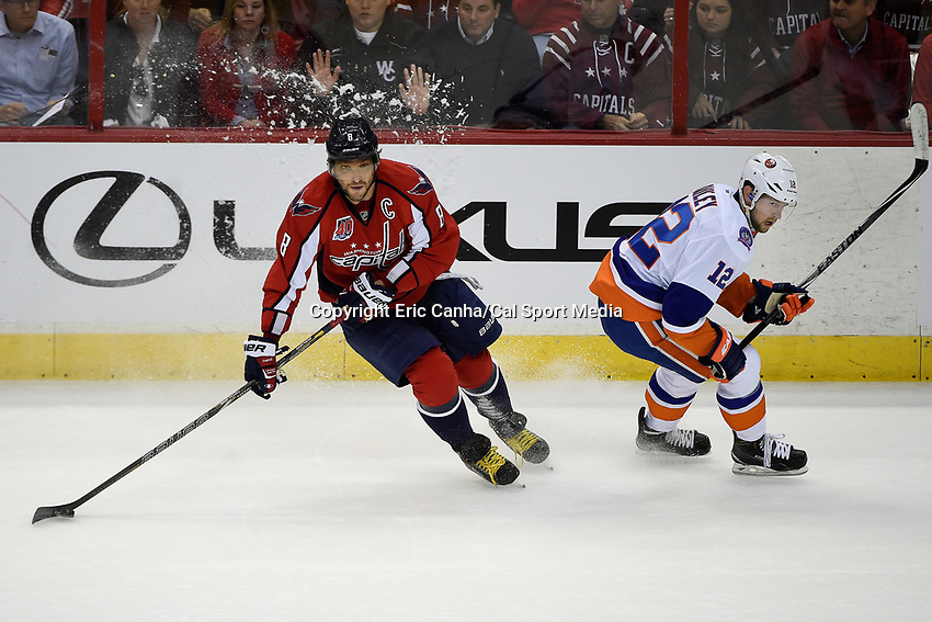 April 23, 2015 - Washington D.C., U.S. -  Snow flies as Washington Capitals left wing Alex Ovechkin (8) doubles back on New York Islanders left wing Josh Bailey (12) with the puck during game 5 of the  NHL Eastern Conference Quarter finals between the New York Islanders and the Washington Capitals held at the Verizon Center in Washington DC.  The Capitals defeat the Islanders 5-1 in regulation time to take the lead in the 7 game series 3-2. Eric Canha/CSM
