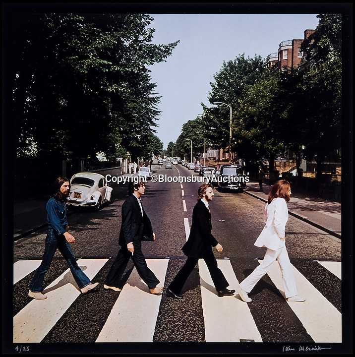 BNPS.co.uk (01202 558833)<br /> Pic: BloomsburyAuctions/BNPS<br /> <br /> ***Please Use Full Byline***<br /> <br /> An out take from the famous Abbey Road photo shoot with The Beatles. <br /> <br /> Rare photographs of the Beatles crossing Abbey Road shot for the cover of the last album they recorded together have emerged for sale for &pound;70,000.<br /> <br /> The six snaps were rejected as possible covers of the Beatles' famed Abbey Road album released in September 1969, just months before they split up.<br /> <br /> They were taken by Scots photographer Iain Macmillan, a close friend of John Lennon, who balanced precariously on a ladder in the middle of the road in north London for the shoot.<br /> <br /> He had just 10 minutes to get his shot so he got the Fab Four to walk back and forth continuously over the now famous zebra crossing.<br /> <br /> Also for sale is the photo that became the back cover of the album - a road sign with a blurred person in the foreground.<br /> <br /> Experts say the photos could make &pound;70,000 when they go under the hammer at Bloomsbury Auctions.