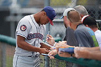 Mahoning Valley Scrappers Will Benson (7) signs autographs after warmups before the first game of a doubleheader against the Auburn Doubledays on July 2, 2017 at Falcon Park in Auburn, New York.  Mahoning Valley defeated Auburn 3-0.  (Mike Janes/Four Seam Images)