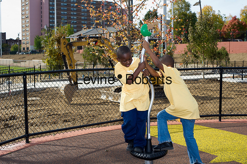 Kids playing at Kompan playground.  Jesse Allen Park Phase II Opening Celebration, Newark, NJ on Wednesday, October 17, 2012. KIDS IN TPL T SHIRTS ARE MODEL RELEASED.  (© Frances M. Roberts)