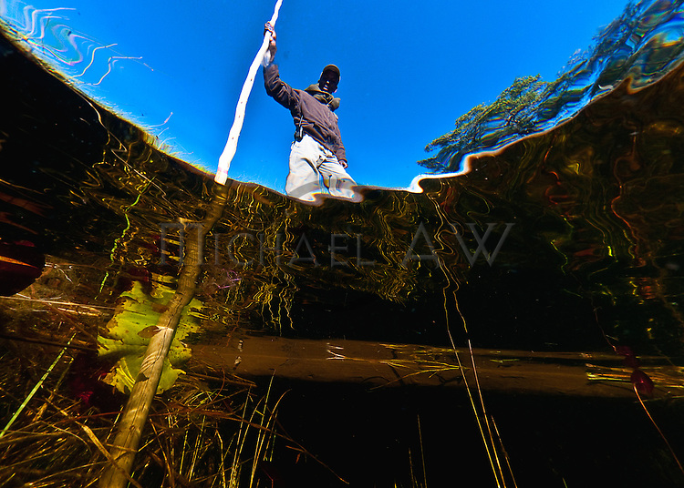local looking into the water - Okavango delta