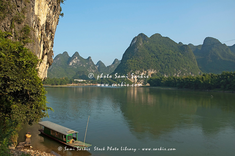 Boat moored on the banks of the River Li in Xinping, Guangxi, China.
