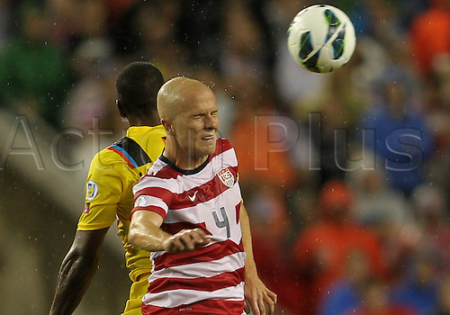 08.06.2012. Tampa, Florida, USA.  Michael Bradley (4) of USA MNT heads away from Mark McCoy (2) of Antigua & Barbuda during a 2014 FIFA World Cup qualifying match at Raymond James Stadium in Tampa, Florida. USA won 3-1.