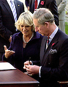 Washington, D.C. - November 2, 2005 -- Camilla, the Duchess of Cornwall shows her hand with some ink on it from a leaking pen to her husband, Charles, the Prince of Wales,  wipes ink off a leaking pen during a visit the School of Education Evolution and Development (SEED) School in Washington, D.C. on November 2, 2005.  The SEED School is a public charter boarding school..Credit: Ron Sachs / CNP.(Restriction: No New York Metro or other Newspapers within a 75 mile radius of New York City)