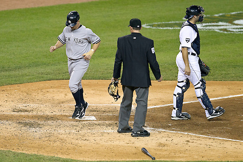 October 04, 2011:  New York Yankees left fielder Brett Gardner (#11) scores run during MLB American League Division Series game action between the New York Yankees and the Detroit Tigers at Comerica Park in Detroit, Michigan.  The Yankees defeated the Tigers 10-1.