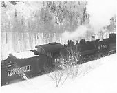 3/4 rear view of C&amp;TS #483 &amp; #487 pushing rotary snowplow #OM east of Chama.<br /> C&amp;TS  e. of Chama, NM